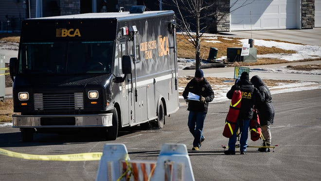 Investigators from the Minnesota Bureau of Criminal Apprehension collect evidence after a shooting Friday, Feb. 16, at 3466 Old Creek Place in Sauk Rapids.