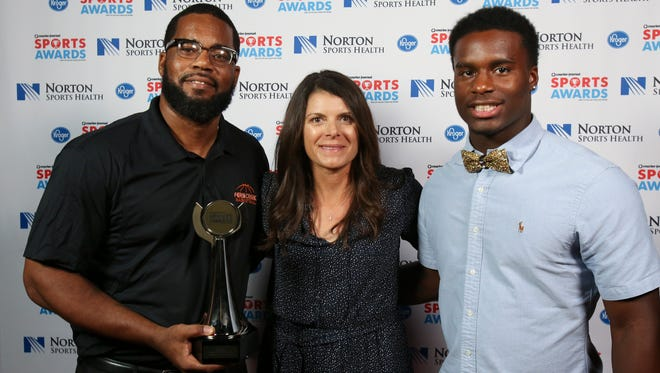 Two-time U.S. Olympic gold medalist Mia Hamm, center, posed with James Schooler, left, and Kyree Hawkins during the CJ Sports Awards.June 12, 2017