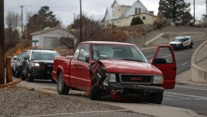 A GMC pickup truck that was damaged during a high-speed pursuit by police is parked Thursday at 400 Vine Ave. in Farmington.
