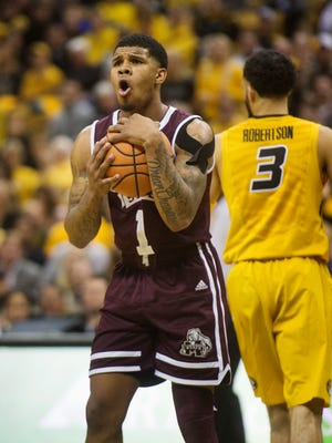 Mississippi State's Lamar Peters, left, reacts after getting called for a foul on Missouri's Kassius Robertson, right, during the second half of an NCAA college basketball game Saturday, Feb. 10, 2018, in Columbia, Mo. Missouri won the game 89-85 in overtime. (AP Photo/L.G. Patterson)