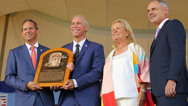 Former Tigers shortstop Alan Trammell (second from left) holds his plaque during the Baseball Hall of Fame induction ceremony Sunday in Cooperstown, N.Y.