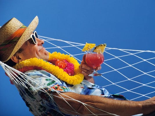 mature-man-in-hammock-with-drink_large.jpg