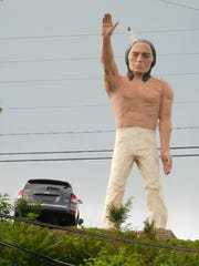 This statue of Chief Pontiac sits in the used car lot