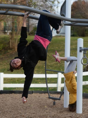 The playground at Centerville's Maplewood Park is used as a hangout spot by Kaylynn Phillips, left, and Hannah Dillon.