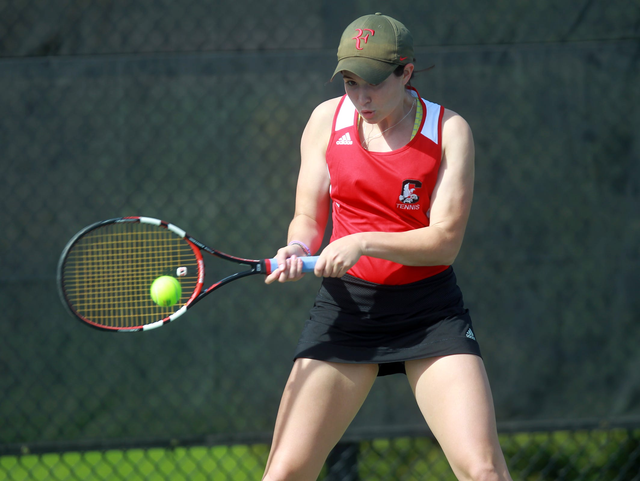 City High's Innes Hicsasmaz returns a shot during her match against West High's Hannah Smigel at the Hawkeye Tennis and Recreation Complex on Tuesday.