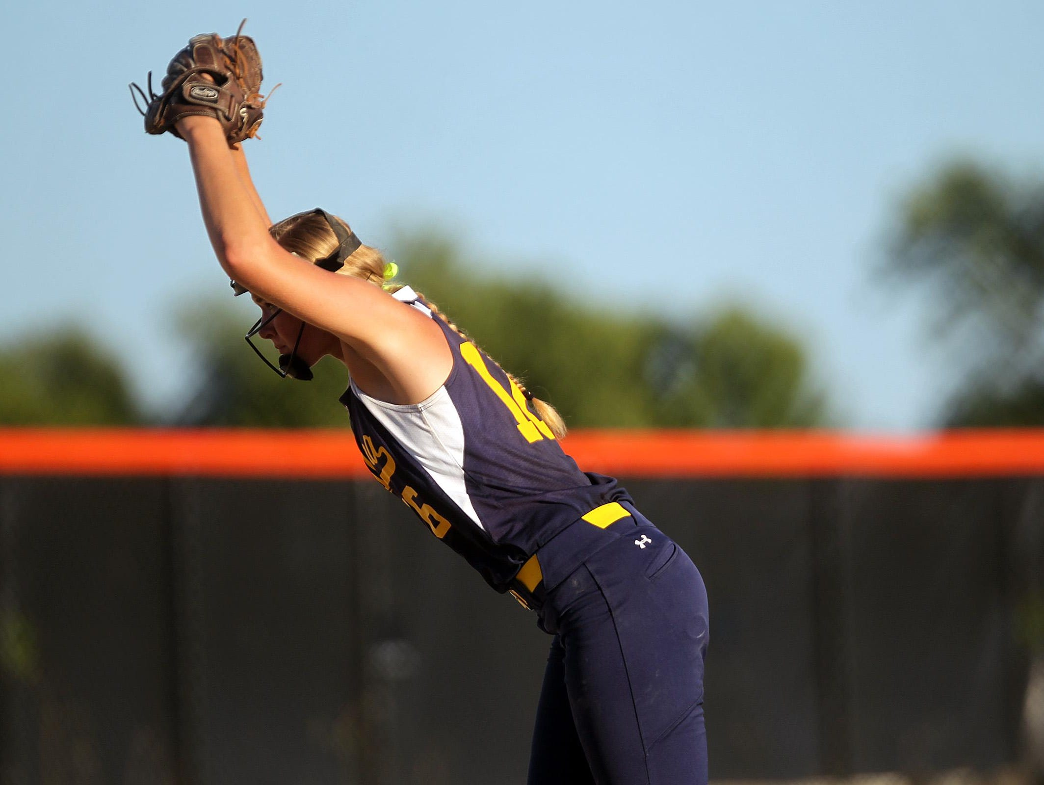 Regina pitcher Sarah Lehman winds up for a pitch during the Regals' Class 2A regional championship against Collins-Maxwell/Baxter in Grinnell on Monday, July 13, 2015.