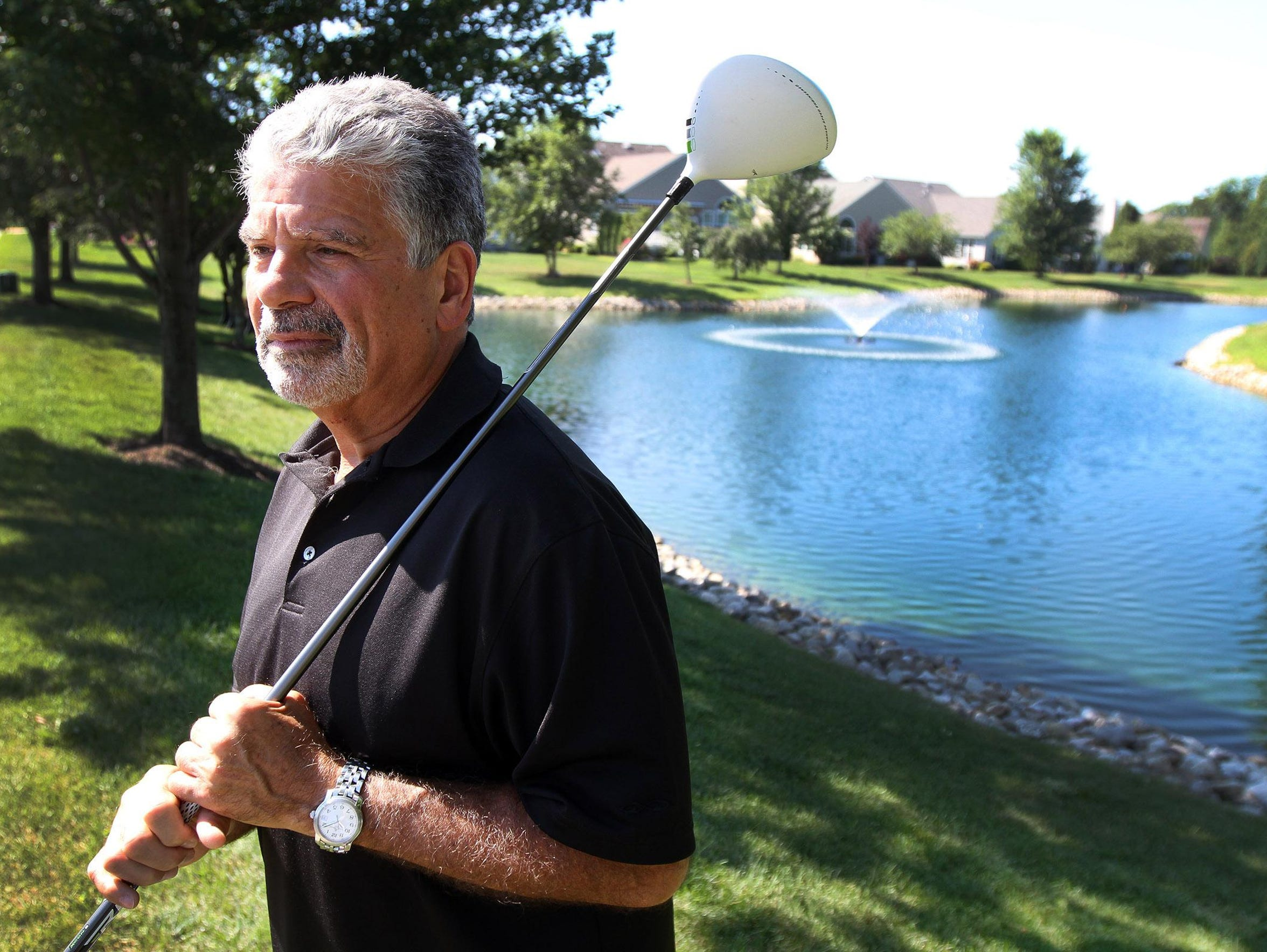 Tom Gatti, a resident of The Enclave, a gated golf