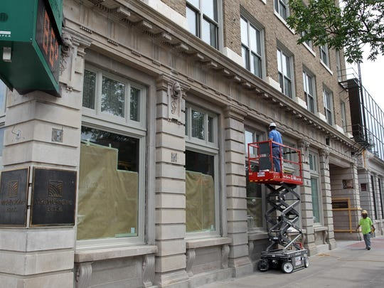 MidWestOne Bank: Work continues at the bank on Clinton Street on Monday. Renovations started in 2013 on the six-story, over 100-year-old at 102 S. Clinton St. The renovation projects will cost the $12 million, but will restore the main building to its original 1912 style.
