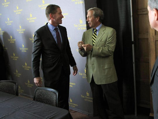 Iowa Board of Regents President Bruce Rastetter, left,