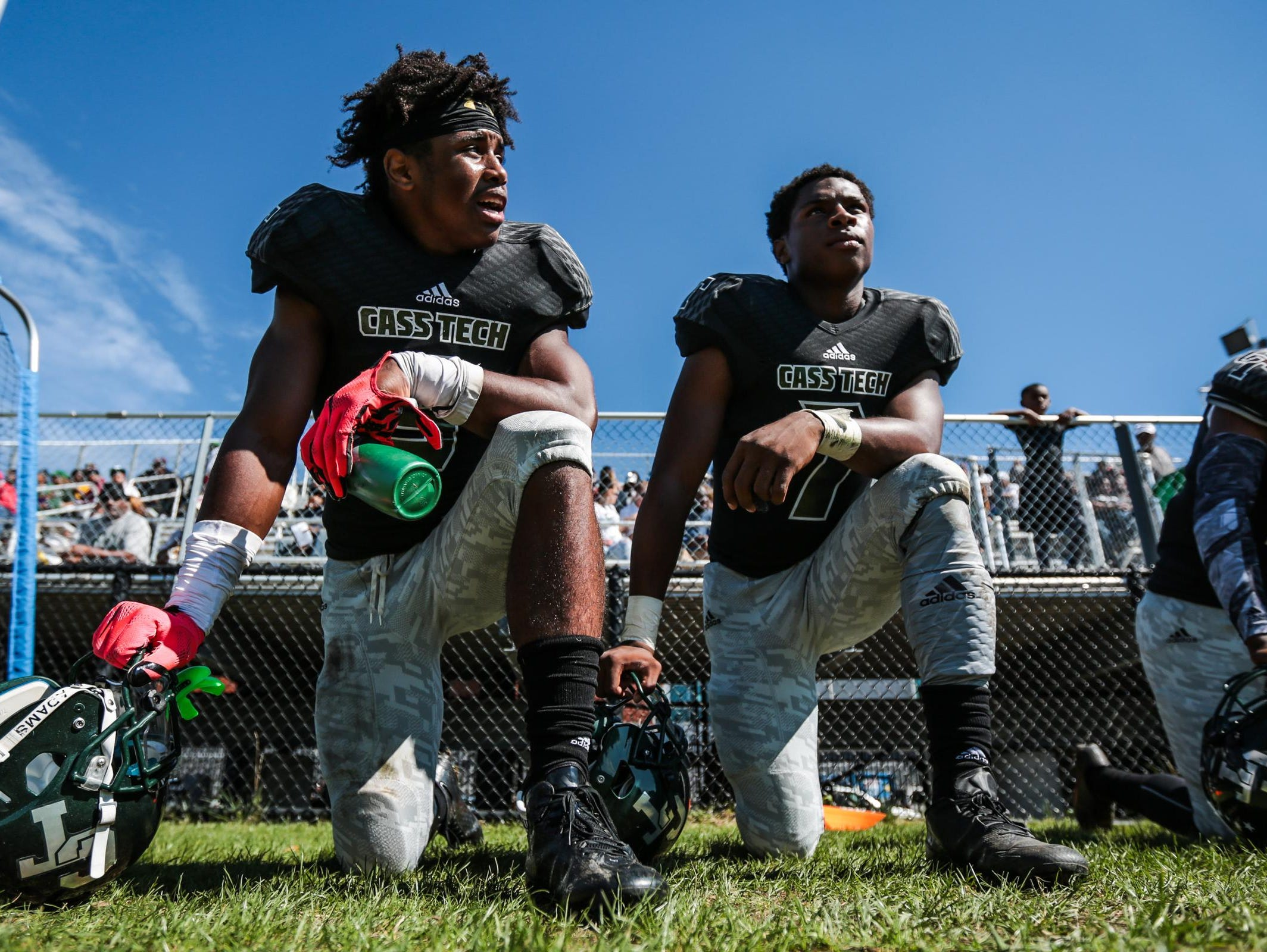 Detroit Cass Tech's Donovan Peoples-Jones, left, and Rodney Hall have played football with Donovan Johnson and Donovan Parker for 8 years. All are college recruits hoping to lead the Technicians to the state title.