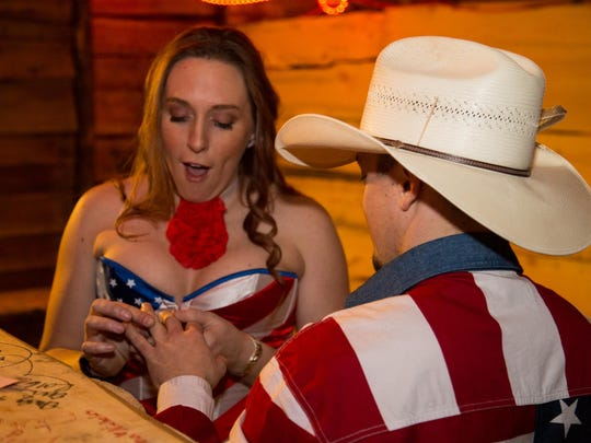 Kate Page puts a ring on her boyfriend Rocky Gardipee's finger after being wed at the St. Grapple chapel at the 99th annual Foresters Ball in the Schreiber Gymnasium at the University of Montana on Feb. 6, 2015.