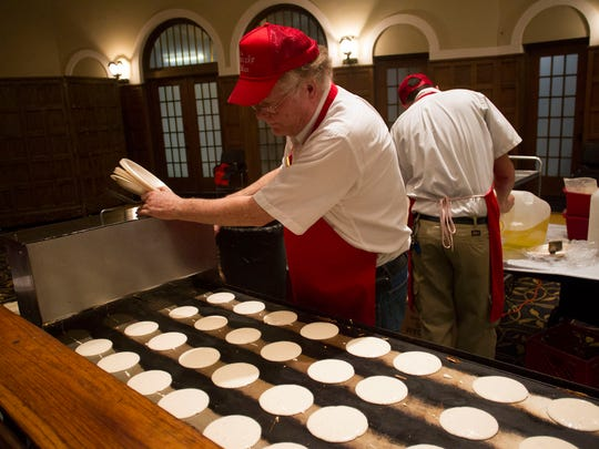 "Jim ""The Pancake Man"" Kuper prepares pancakes for University"