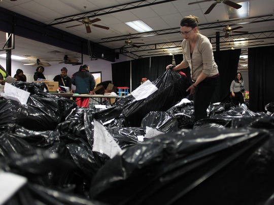 Marcia McKeag sorts through bags of toys for families during the Salvation Army's annual toy distribution on Thursday, Dec. 18, 2014. Around 500 families received toys on Thursday, with up to 200 more coming today (Friday) for a second round of distribution. David Scrivner / Iowa City Press-Citizen