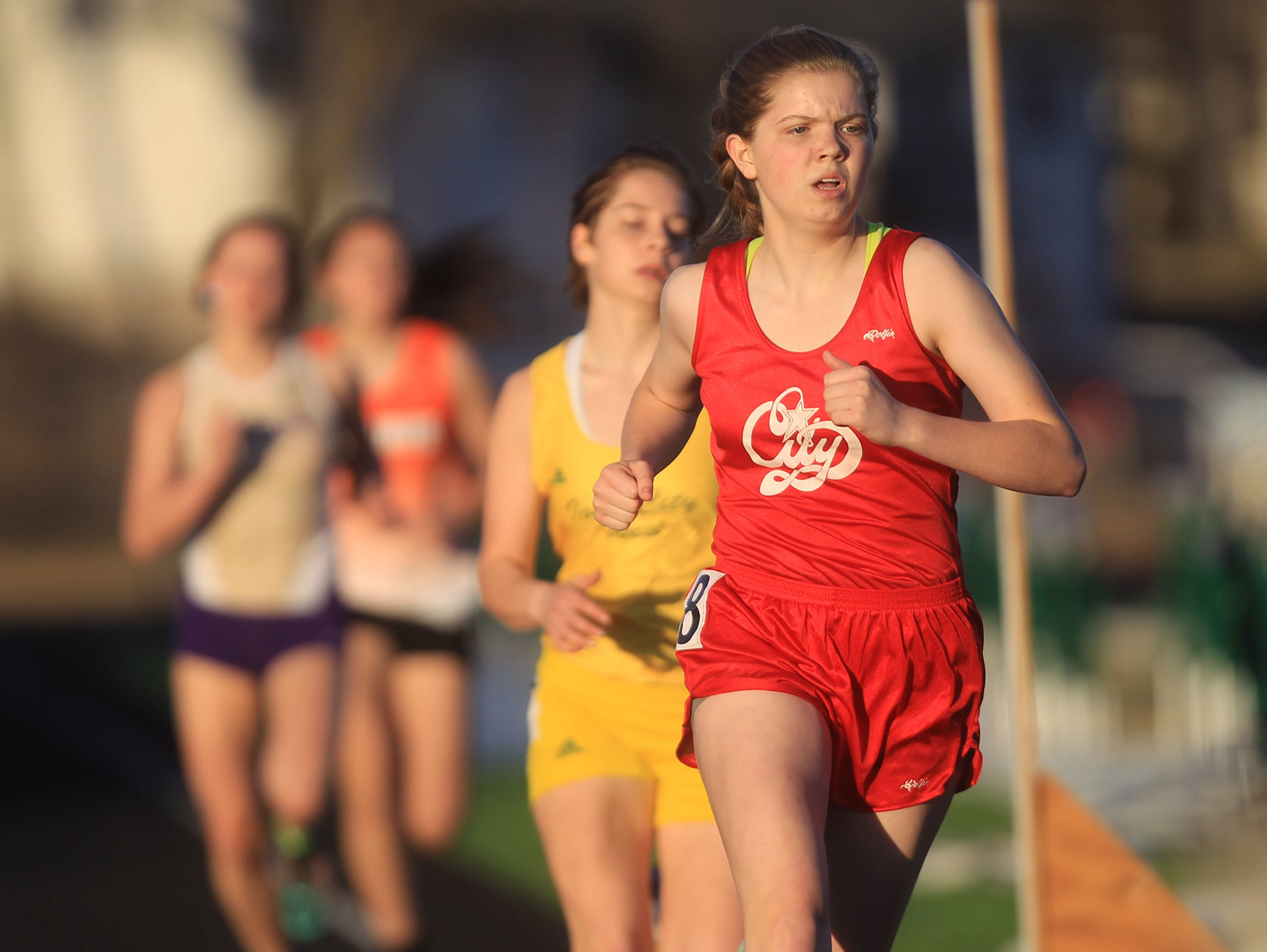 City High's Addy Smith competes in the 800 meter run at the Women of Troy Relays at West High on Tuesday, March 31, 2015. David Scrivner / Iowa City Press-Citizen