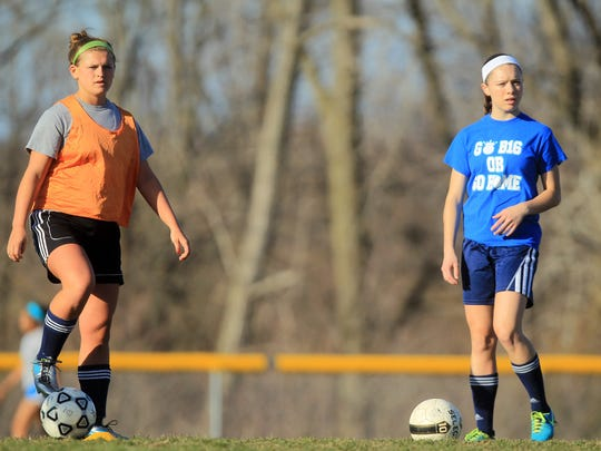 Regina's Jenny Wick, left, and Lauren Ronnfeldt practice on Monday. Ronnfeldt led Regina with 22 goals while Wick is going into the season healthy after suffering a torn ACL in 2014.