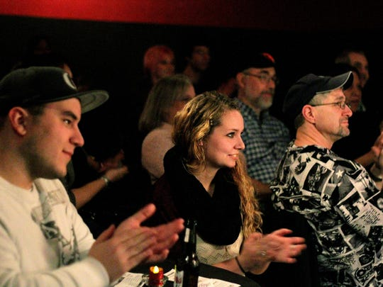 Audience members applaud during an improv comedy show at the Capitol City Theater.