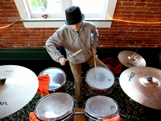 Isaac King of Salem, drums during a rehearsal for the River City Rock Star Academy at the Reed Opera House in Salem.