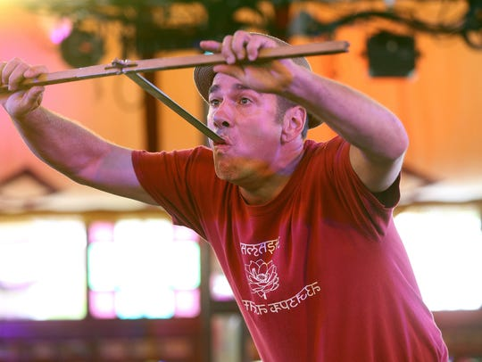Keith Nelson swallows a sword during a rehearsal in the Spiegeltent for the Rochester Fringe Festival (2016 file photo).