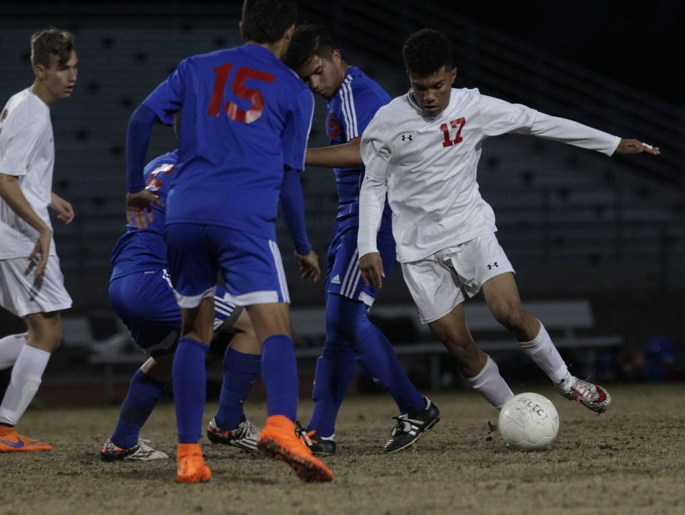 In white uniforms, Palm Desert High School goes against Indio High School at Palm Desert.