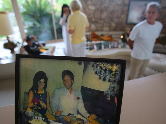 A picture of Priscilla and Elvis Presley in Palm Springs is displayed inside the Elvis Honeymoon Hideaway in Palm Springs. The owners of the house will celebrate what could have been the couple's 50th anniversary on Saturday.