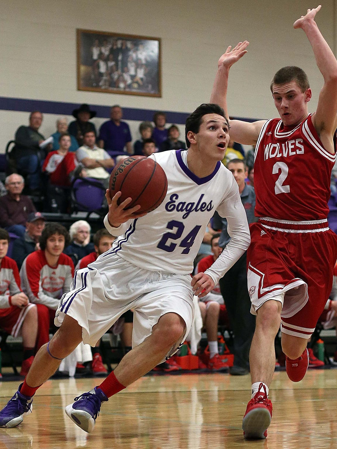 Fair Grove's Kyle Cavanaugh (24) drives to the basket.
