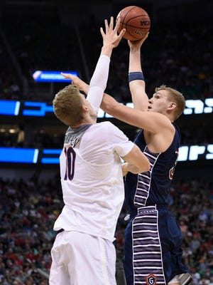 March 18, 2017: Saint Mary's Gaels center Jock Landale (34) scores a basket against Arizona Wildcats forward Lauri Markkanen (10) during the second half in the second round of the 2017 NCAA Tournament at Vivint Smart Home Arena.