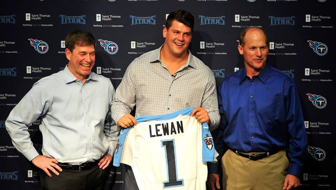 Titans first-round pick Taylor Lewan, center, was all smiles with GM Ruston Webster, left, and coach Ken Wisenhunt in May.
