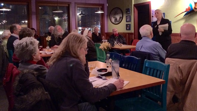 Voters listen as candidates for Circuit Court answer questions posed Thursday night during a forum at the Highland House restaurant in Sheboygan, Wis., on Feb. 5, 2015.