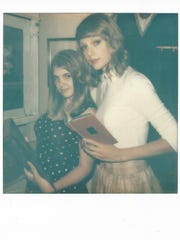 Dyleena Byrd, 23, of Tulare, poses with Taylor Swift. Byrd said she got the choice of what props from Swift's Beverly Hills home she wanted to pose with, and she ultimately chose books.