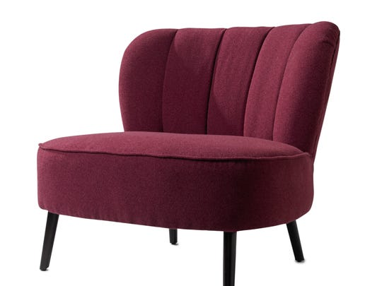 This photo provided by HomeGoods shows a slipper chair in Pantone?s Color of the Year, Radiant Orchid, which enlivens the upholstery. After the brutal bite of winter, even a gloomy spring day welcomes us with warmer breezes and an emerging palette of delicate hues. We welcome both the pale, early buds and the saucy bursts of color that follow. (AP Photo/HomeGoods)