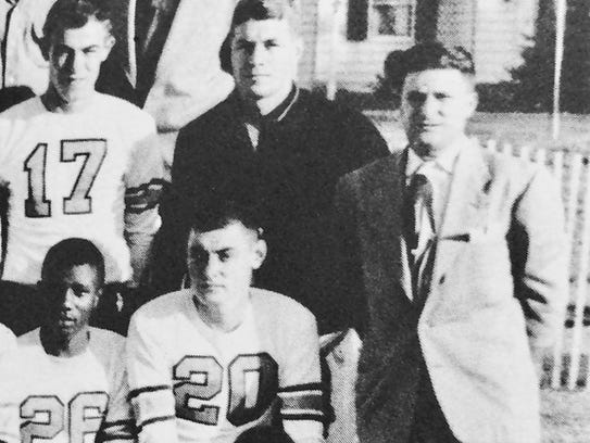 Freehold coach Hal Schank (right) in a 1953 team photo.