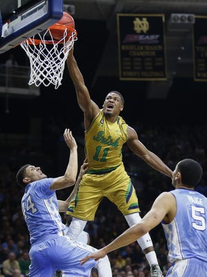 Demetrius Jackson of the Notre Dame Fighting Irish goes up for the dunk against Justin Jackson of the North Carolina Tar Heels at Purcell Pavilion.