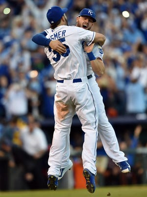 Oct 15, 2014; Kansas City, MO, USA; Kansas City Royals infielders Eric Hosmer (35) and Mike Moustakas (8) celebrate after defeating the Baltimore Orioles in game four of the 2014 ALCS playoff baseball game at Kauffman Stadium. The Royals swept the Orioles to advance to the World Series. Mandatory Credit: Peter G. Aiken-USA TODAY Sports