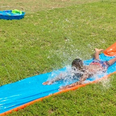This July 23, 2016 photo shows a boy on a waterslide