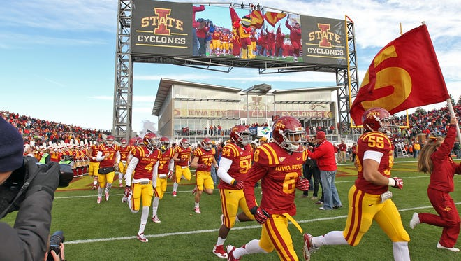 Iowa State players take the field against Oklahoma State at Jack Trice Stadium in Ames on Oct. 26, 2013.