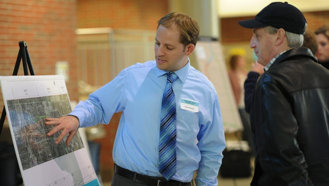 Chris Schultz from CHA consulting talks about  The New US 31 Hamilton County project with Carmel resident Gary Noonan, in the cafeteria at Carmel High School Tuesday March 18, 2014. The Major Moves project will run through at least 2015.