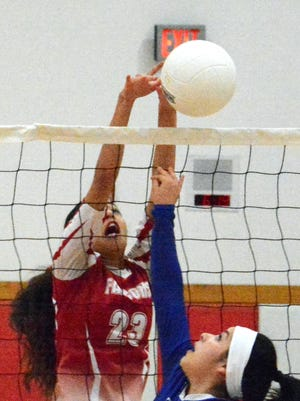Loving junior outside hitter Liana Rodriguez blocks a quick kill attempt by Dexter senior setter Vanessa Salayandia in the first set Thursday.