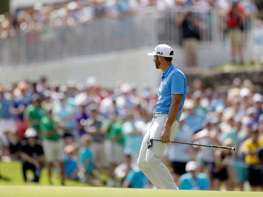 Dustin Johnson reacts as he misses a putt on the sixth hole during the final round of play at the Dell Technologies Match Play golf tournament at Austin County Club, Sunday, March 26, 2017, in Austin, Texas. (AP Photo/Eric Gay)