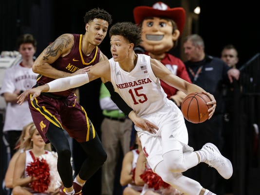 Nebraska's Isaiah Roby (15) tries to drive around Minnesota's Amir Coffey during the first half of an NCAA college basketball game in Lincoln, Neb., Tuesday, Dec. 5, 2017. (AP Photo/Nati Harnik)
