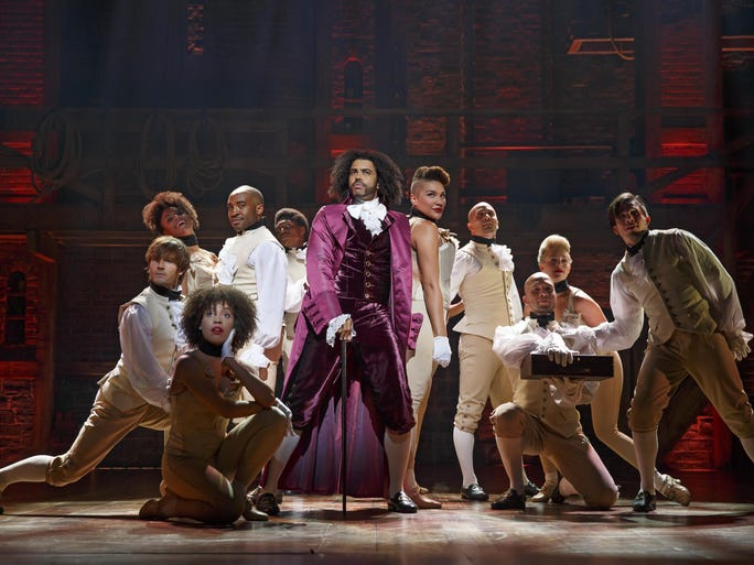 """Daveed Diggs (center) and the cast of """"Hamilton."""""""