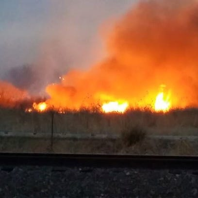 An estimated 60-acre wild fire burning near Fowler