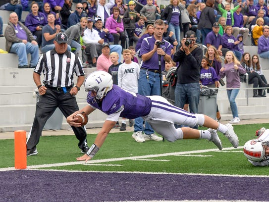 Elder quarterback Michael Bittner dives into the end