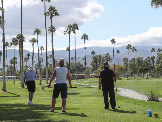 Golfers tee off on the first hole at Shadow Mountain