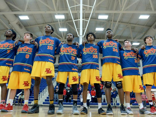 Purcell Marian players stand during the National Anthem