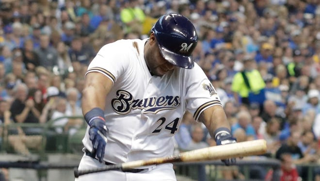 Brewers slugger Jesus Aguilar is quite irritated with himself as he throws his bat aside after striking out swinging against Dodgers ace Clayton Kershaw to end the first inning Saturday night.