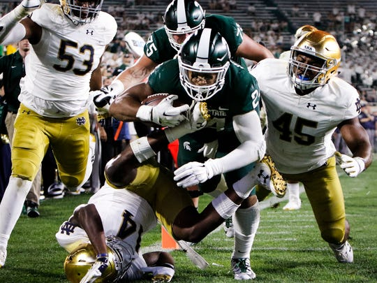 MSU RB Gerald Holmes makes it into the end zone for