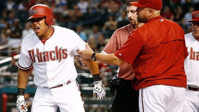 Arizona Diamondbacks hitter Yasmany Tomas reacts after being hit by a pitch by San Diego Padres ace James Shields in the first inning on Friday, June 19, 2015, at Chase Field in Phoenix.