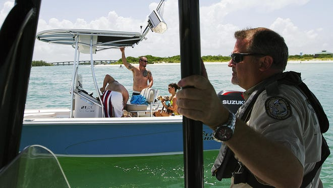 Officer Gregory Bryson, of the Florida Fish and Wildlife Conservation Commission, patrols the New Pass section of Estero Bay on Saturday. The FWC is beginning patrols in preparation for the upcoming Fourth of July weekend.