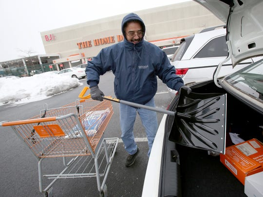 Jesus Munoz of Congers bought a snow shovel and salt at the Home Depot in West Nyack to prepare for the coming snowstorm Jan. 26, 2015. The shovel wouldn't fit in his trunk, so he put it in the front seat.