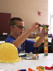 Third grader Lucas Wells concentrates on building something.